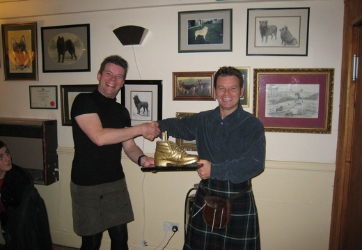 Handing the Golden Boot over to Scott