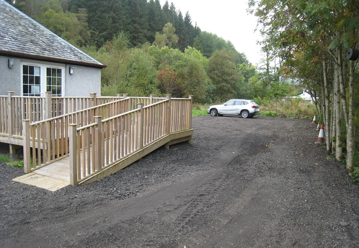 View past extension and decking to rear car park